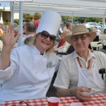 Bar B Que Genuis Norman and Chef Kristeen take quick break while feeding everyone.
