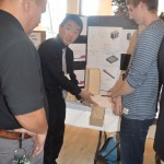 Students describe their prototype for a senior friendly closet organizing system.