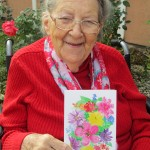 Irma Zimmer with her printed card.