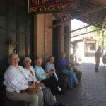 Folks resting after touring an old west museum.