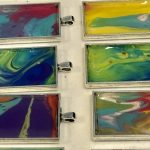 Beautiful acrylic fluid art jewelry created by our Memory Care residents.